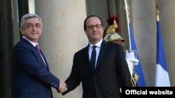 France -- France's President Francois Hollande greets his Armenian counterpart Serzh Sarkisian in Paris, 27Oct, 2014