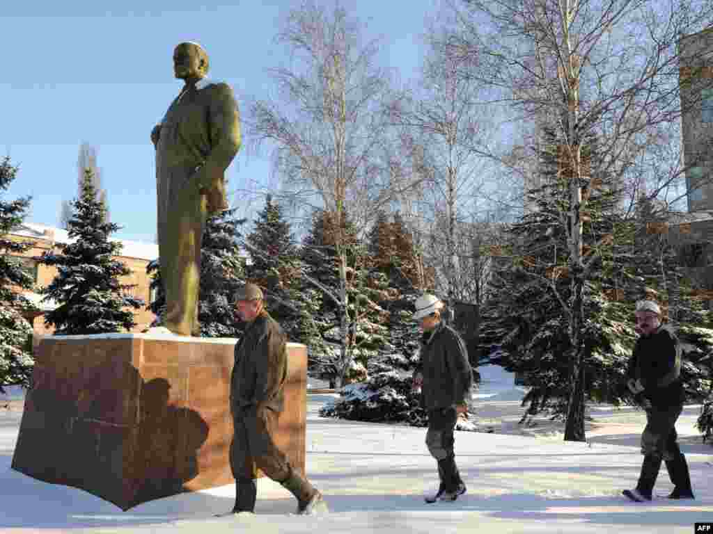 Ukrainian coal miners walk past a statue of Lenin on their way to a polling station in the eastern town of Gorlovka.