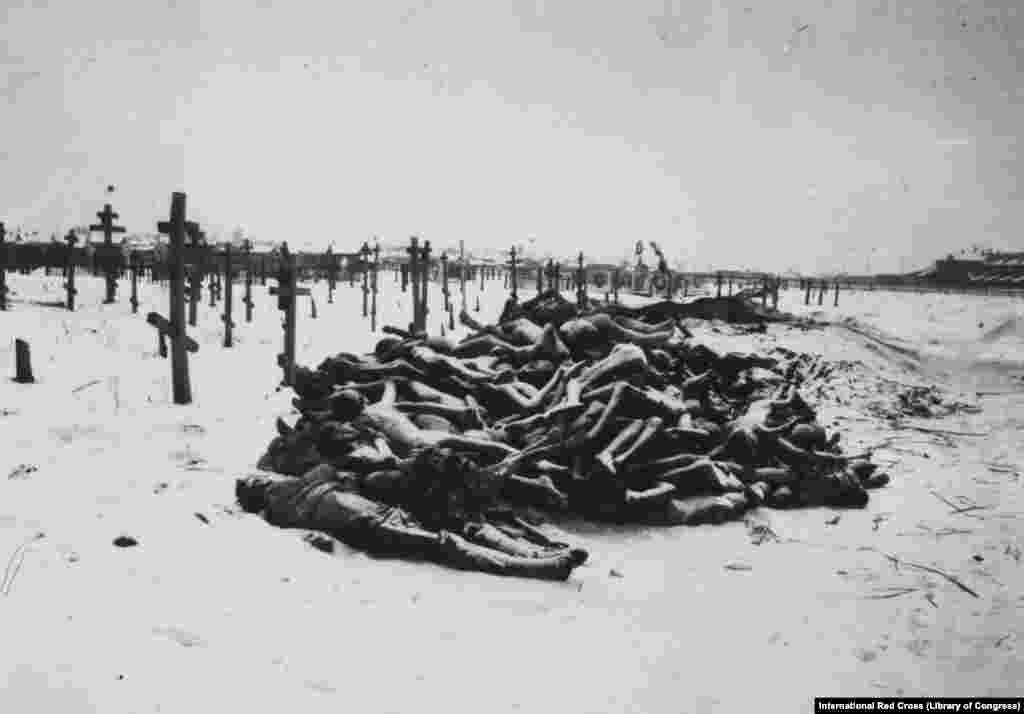 """Victims of the famine that followed, stacked like firewood outside a cemetery in Samara in 1921. Eastern Russia at the time was deemed """"too chaotic"""" for aid operations. The famine would soon add more millions to the number of Russian soldiers killed in World War I and the millions killed in the civil war. (photo via International Red Cross)"""
