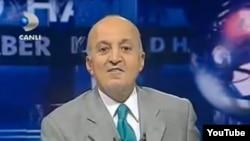 Журналист Мехмет Али Биранд