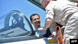Syrian President Bashar al-Assad sits inside a Sukhoi Su-27 jet during his visit to the Russian air base at Hmeimim on June 27.