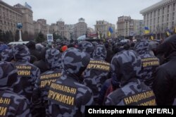 Election observers: Members of the National Militia rally in central Kyiv on March 16.