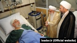 Ayatollah Ahmad Jannati (C) 91, and Judiciary chief Sadeq Larijani (R) visit Iranian supreme leader, Ayatollah Ali Khamenei after his prostate operation at a hospital in Tehran, 08Sep2014. File photo