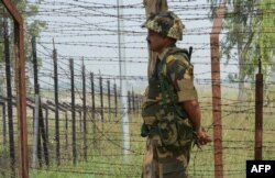 An Indian border guard keeps watch near the line of control in the disputed Kashmir region.