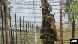 An Indian Border Security Force soldier keeps guard at an Indian-Pakistani border post in Kashmir.