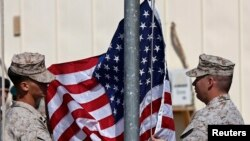 U.S. Marines lower their flag during a handover ceremony in Helmand on October 26, 2014