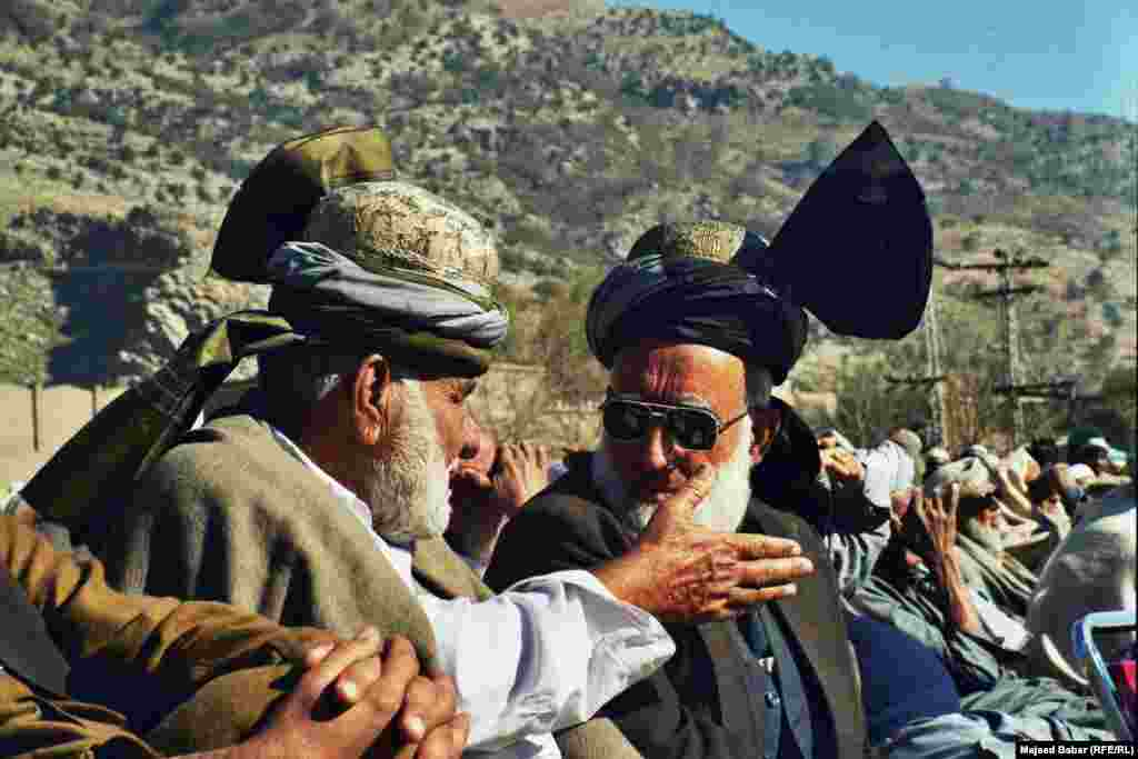 Deliberations are a part of the jirga. Here, two clan leaders from the Afridi tribe debate the deployment of the Pakistani army to the Federally Administered Tribal Areas in late 2001.
