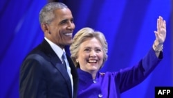 U.S. President Barack Obama (left) and his choice to succeed him, Hillary Clinton, appear at the Democratic National Convention in Philadelphia.