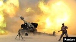 Артиллерийский залп сил безопасности Ирака близ города Фаллуджа. 29 мая 2016 года.