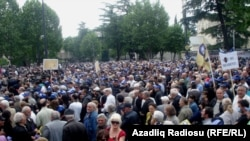 Georgian opposition protesters rally against President Mikheil Saakashvili in Tbilisi on May 25.