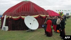 Turkmenistan -- A satellite dish is mounted next to a traditional tent in Ashgabat, August 16, 2011.