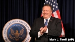 U. S. Secretary of State Mike Pompeo claps before being introduced at the Ronald Reagan Presidential Library Sunday, July 22, 2018, in Simi Valley, Calif.
