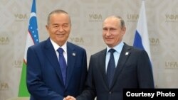File photo of President of Uzbekistan Islam Karimov and President of Vladimir Putin.