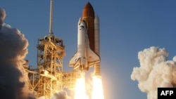 The space shuttle Discovery lifts off from Kennedy Space Center in Florida.