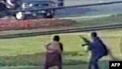 A TV video grab shows the unidentified gunmen firing their weapons during an attack on a vehicle carrying the Sri Lankan cricket team in Lahore on March 3.