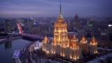 Russia -- Hotel Ukraina lit up at dusk. December 2013