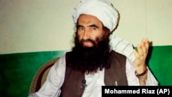 PAKISTAN -- Jalaluddin Haqqani, founder of the militant group the Haqqani network, speaks during an interview in Miram Shah, August 22, 1998