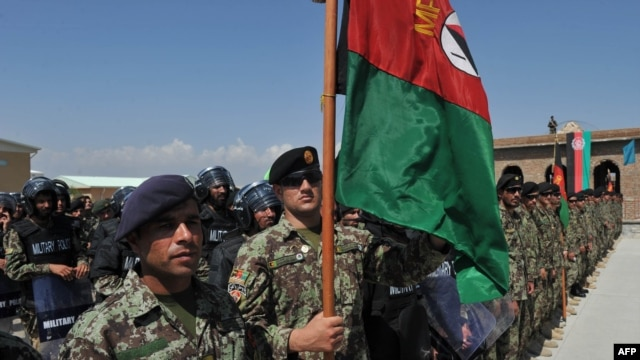 Afghan National Army soldiers stand in formation during a ceremony handing control of Bagram prison over to Afghan authorities.