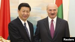 Chinese Vice President Xi Jinping (left) and Belarus President Alyaksandr Lukashenka met for talks in Minsk on March 24.