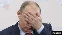 Ресей премьер-министрі, ел президенттігінен үміткер Владимир Путин. Мәскеу, 9 ақпан 2012 жыл. (Көрнекі сурет).