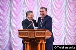 All smiles: The Tajik and Uzbek presidents, Emomali Rahmon (right) and Shavkat Mirziyoev, meet in Dushanbe on March 9.