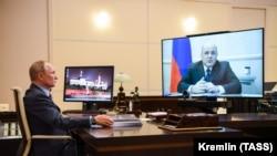 Рускиот претседател Владимир Путин и премиерот Михаил Мишустин