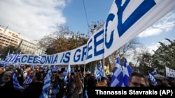 "A banner reads ""Macedonia is Greece"" as demonstrators wave Greek flags during a rally in Athens on January 20."