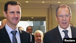 Syrian President Bashar al-Assad (left) and Russian Foreign Minister Sergei Lavrov in Damascus on February 7