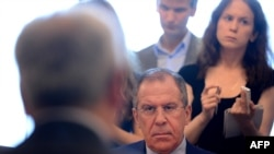 Russian Foreign Minister Sergei Lavrov (facing camera) meets Syrian National Council representatives at the Foreign Ministry in Moscow on July 11.
