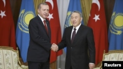 FILE: Kazakh President Nursultan Nazarbaev (R) with his Turkish counterpart Tayyip Erdogan.