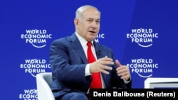 Israel's Prime Minister Benjamin Netanyahu gestures as he speaks the World Economic Forum (WEF) annual meeting in Davos, Switzerland January 25, 2018