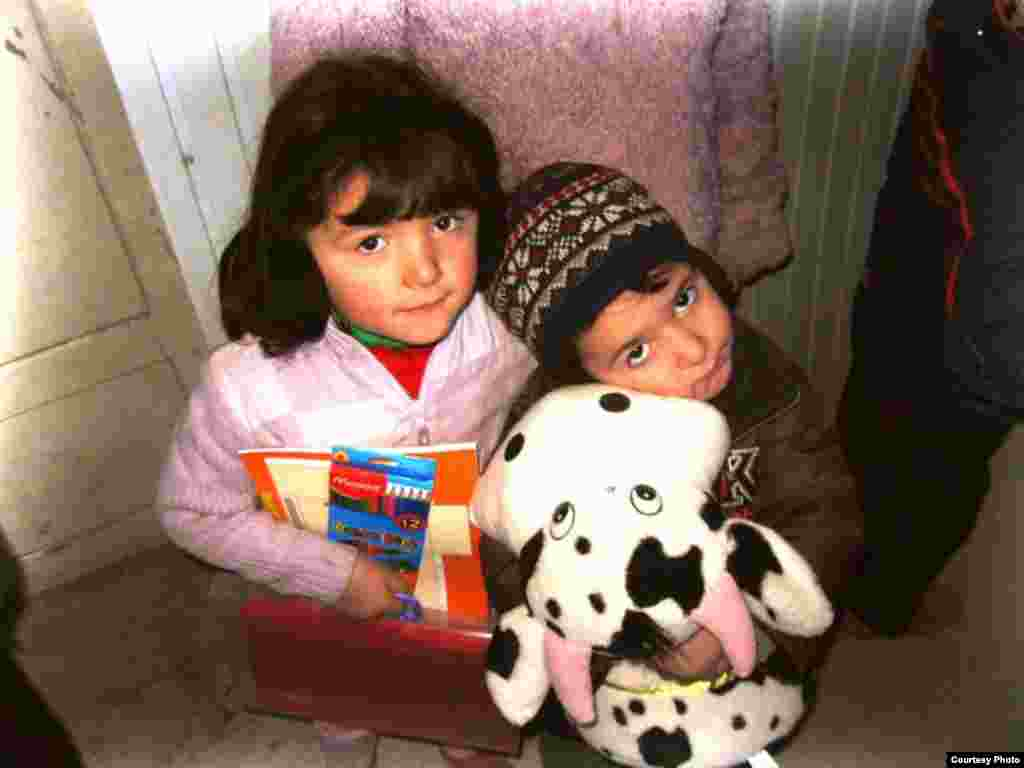 Children pose with their New Year's presents.