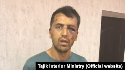 An image of Hussein Abdusamadov in Tajik police custody.