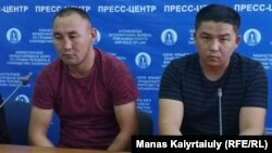 Qaster Musakhanuly (left) and Murager Alimuly speak to the press in Almaty on October 14.
