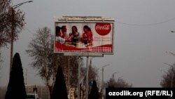 Uzbekistan - advertisement banner (together delicious) of Coca Cola in Margilan city, 31 March 2012