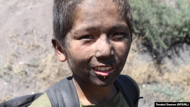Eleven-year old Nurbek, working in a coal mine in Sulukta, Kyrgyzstan, 14 Aug 2012