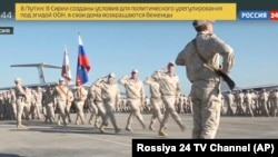 Russian troops march at the Hmeimim military base in Syria.