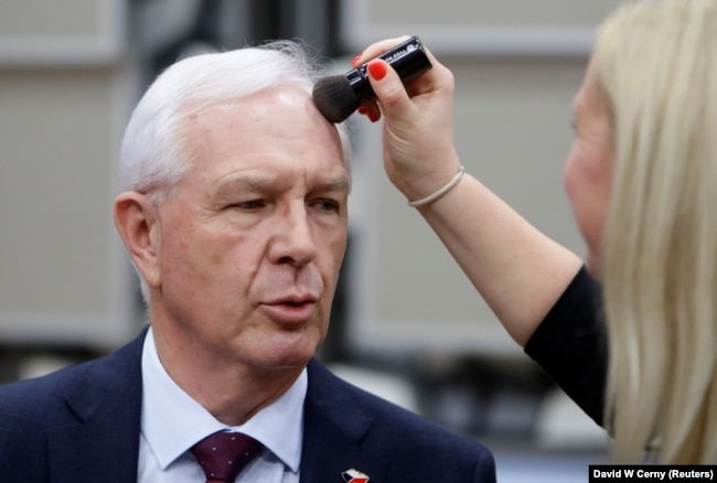 Czech presidential candidate Jiri Drahos has makeup applied ahead of a debate in Prague on December 12.