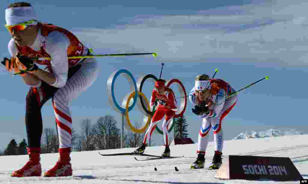 (From left) Austria's Katerina Smutna, Poland's Kornelia Kubinska and France's Aurore Jean compete in the women's cross-country skiing 4x5km relay. (AFP/Kirril Kudryavtsev)