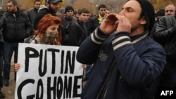 Anti-Putin demonstrators rally in Yerevan on December 2.