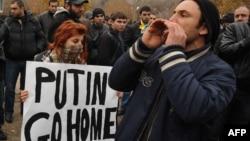 Anti-Putin demonstrators rally in Yerevan on December 2.