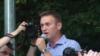 Opposition leader Aleksei Navalny addresses demonstrators protesting against new antiterror legislation in Russia on August 9.