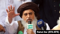 FILE: Khadim Hussain Rizvi, head of religious political Tehreek-e-Labbaik Pakistan, speaks to supporters in Lahore.