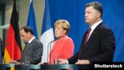 Франсуа Олланд, Ангела Меркель і Петро Порошенко, архівне фото (©Shutterstock)