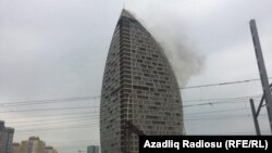 Smoke billows from the 33-floor hotel and condominium tower, one of the tallest buildings in Baku.
