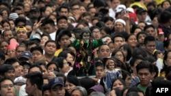 Люди собрались на мессу Папы Римского в столице Филиппин - Маниле. 18 января 2015 года.