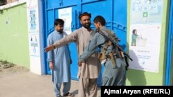 Afghan police check a voter who wanted to enter a voting center in Kunduz Province.