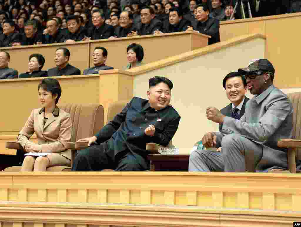 A photo released by North Korea's official Korean Central News Agency shows Kim Jong Un (center), his wife Ri Sol Ju (left) and former NBA star Dennis Rodman (right) watching a basketball game between former NBA players and North Korean players in Pyongyang.