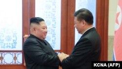 Kim Džong Un i Si Đinping prilikom susreta u januaru 2019.