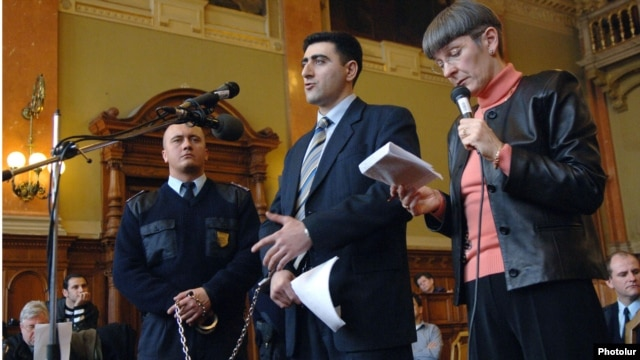 "Azerbaijani military officer Ramil Safarov (center) testifies at his trial in Budapest in April 2006 to having hacked to death an Armenian soldier over an ""insult."""